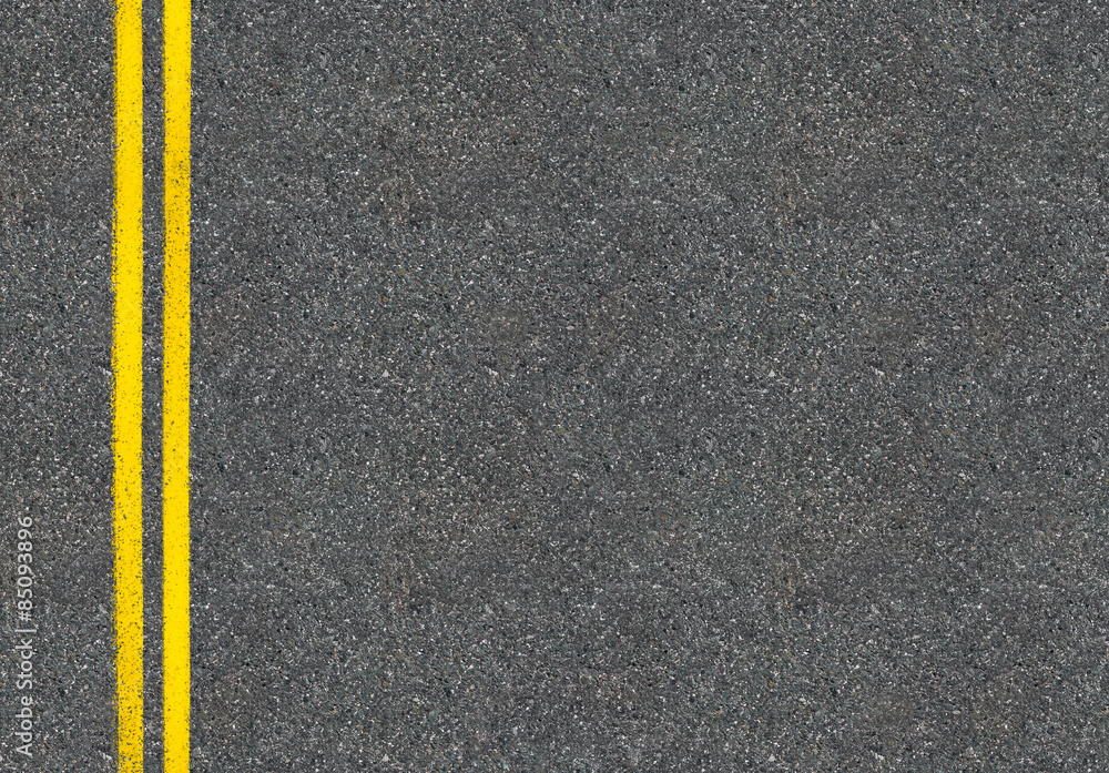 Fototapeta Asphalt road top view with two yellow lines