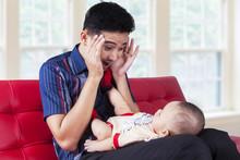 Dad Play Peekaboo With His Baby