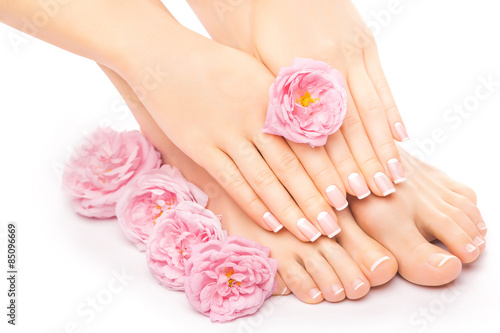 Photo sur Aluminium Pedicure Relaxing pedicure and manicure with a pink rose flower