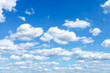 canvas print picture - many white clouds in summer blue sky