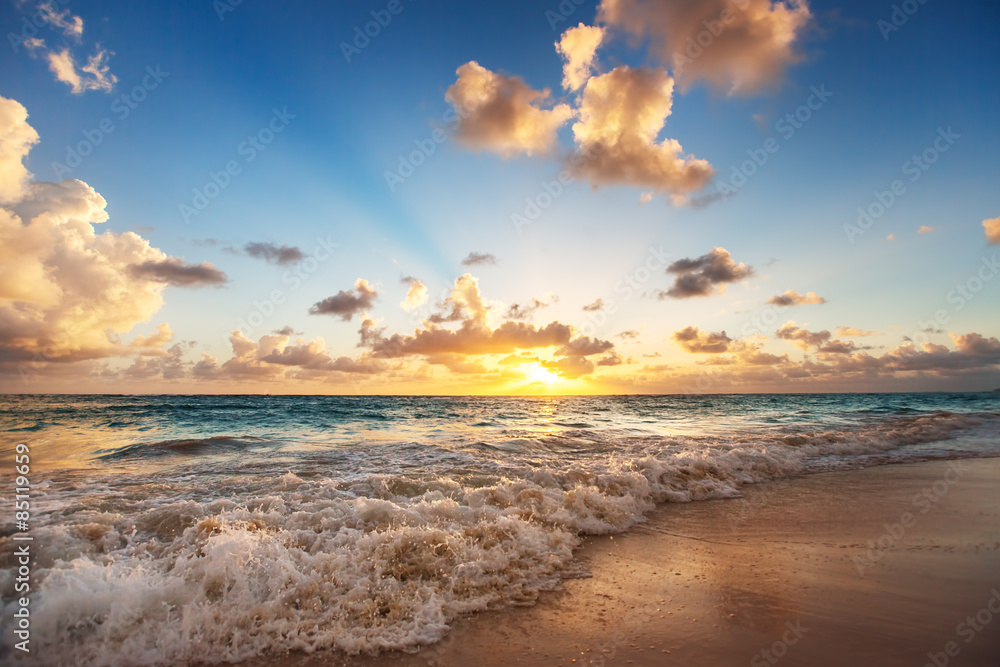 Fototapeta Sunrise on the beach of Caribbean sea