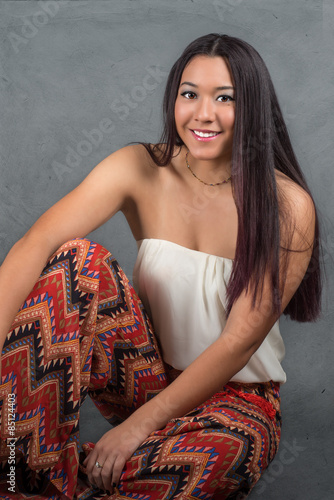 Gorgeous young woman with long dark hair Poster
