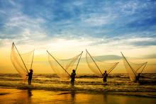 Fishermen Fishing In The Sea A...