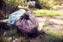 Illegal Dumping In The Nature; Garbage Bags Left In The Nature