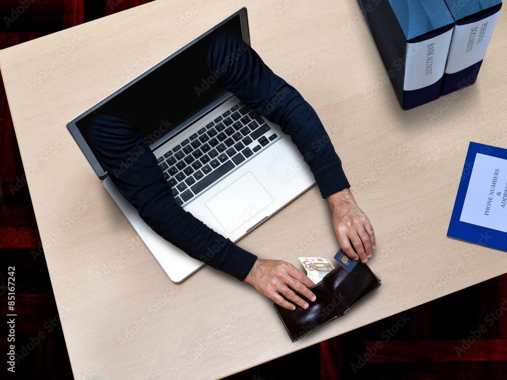 Fototapeta cyber crime fraud in office when hacker stealing credit card and documents