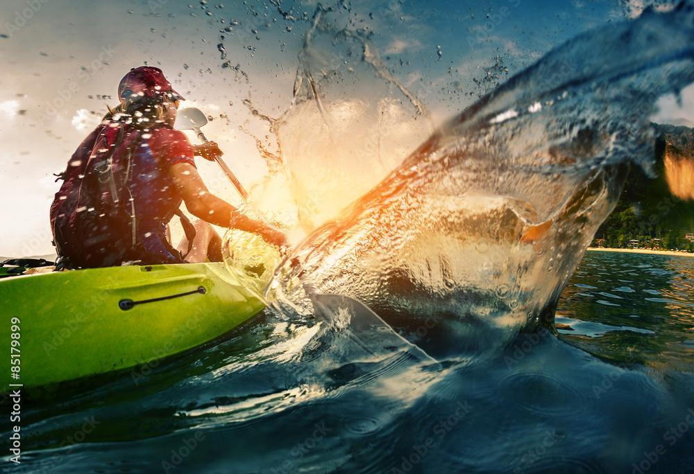 Fototapety, obrazy: Young lady paddling hard