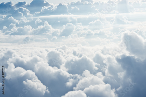 Foto op Canvas Hemel Aerial view on white fluffy clouds