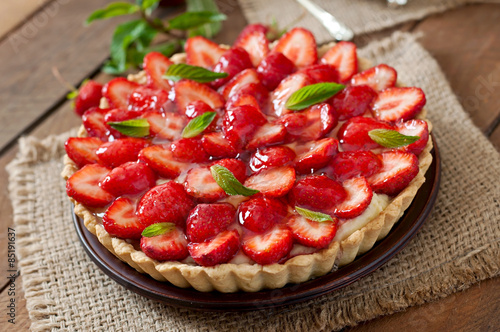 Fotografia, Obraz  Tart with strawberries and whipped cream decorated with mint leaves