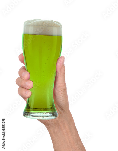 Hand Holding Glass of Foamy Green Beer Poster