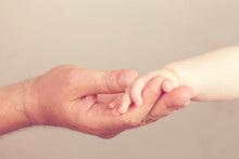 Close Up Photo Of Father Holding Baby Hand