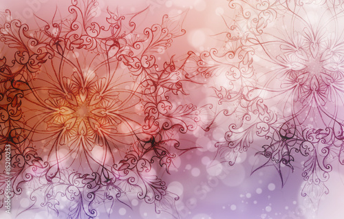 Photo  Flower Mandala on a pink and violet abstract  background