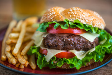 FototapetaHomemade Hamburger with Fresh Vegetables and French Fries