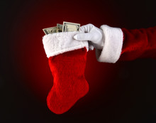 Santa Claus Holding A Stocking Full Of Cash