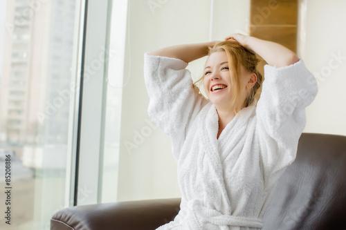 Fotografie, Obraz  beautiful blonde girl in a white robe laughs