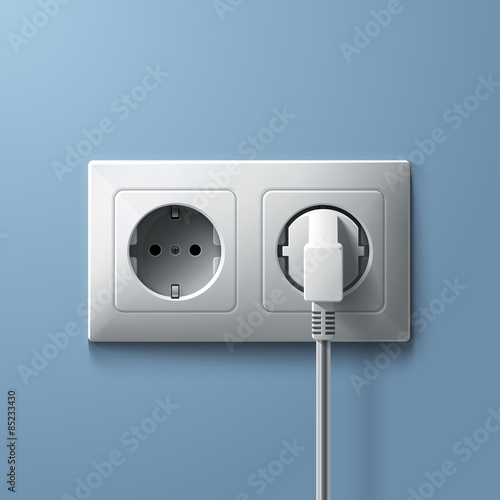 Fotografía  Electric white plug and socket on blue wall background