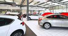 Cars In A Showroom Of A Car De...