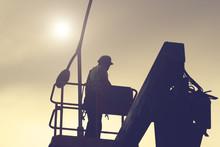 Engineer Working On A Light Pole.