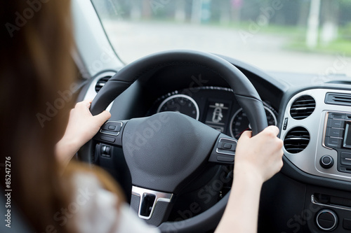Fototapeta Asian beautiful woman driving car portrait