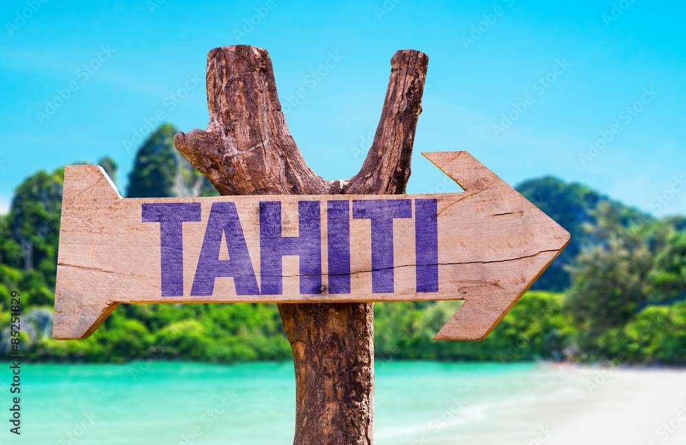 Fototapeta Tahiti wooden sign with beach background