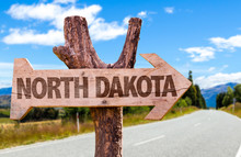 North Dakota Wooden Sign With Road Background