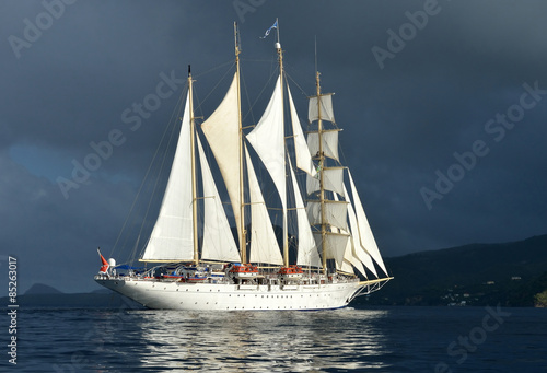 Sailing ship on the background of a stormy sky © Alvov