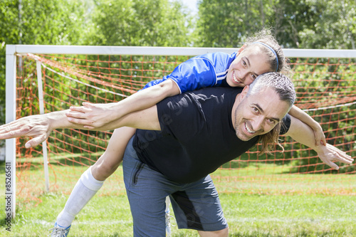 Foto op Aluminium Afrika teenager girl with father play soccer