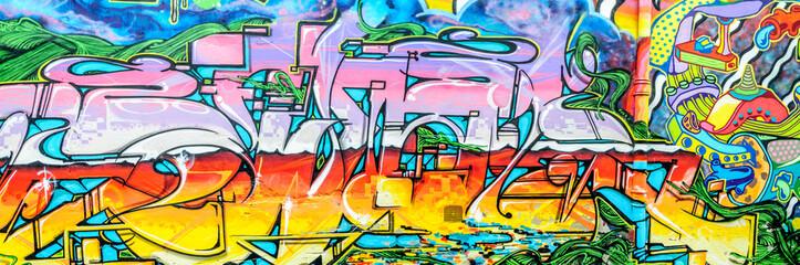 Panel Szklany Graffiti graffitis aux couleurs vives sur murs et gouttières