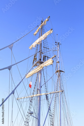 Fotografie, Obraz  Sailing ship mast against a clear blue sky.