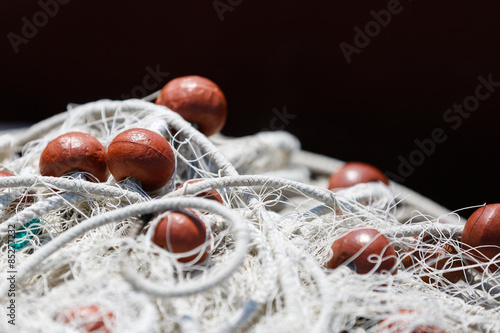 Fishing net with red floats background