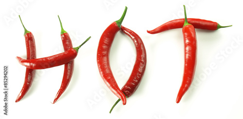 Spoed Foto op Canvas Hot chili peppers Chili pepers creating word hot