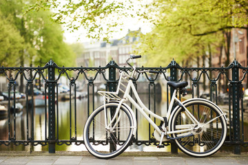 Fototapetabike on amsterdam street in city