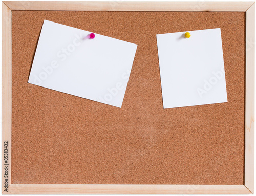 Fotografie, Obraz  Blank papers pin up on cork board isolated on white background