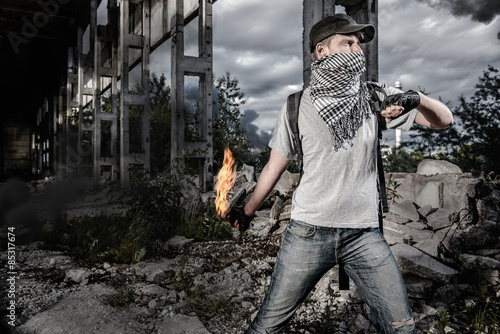 Valokuva  Man with Molotov cocktail