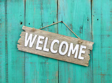 Welcome Sign Hanging On Rustic...