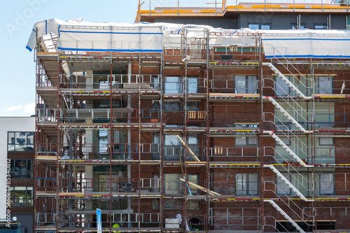 Photo  Construction of new apartments with completed apartments in the