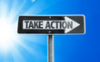 Take Action direction sign with a beautiful day