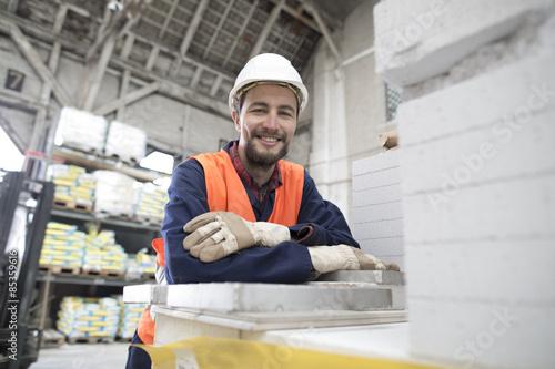 Smiling warehouseman in storehouse