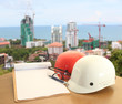 safety helmet on civil engineer working table and work area background
