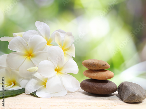 Zen spa concept background - Zen massage stones with frangipani plumeria flower - 85367893