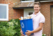 Portrait Of Man Carrying Recyc...