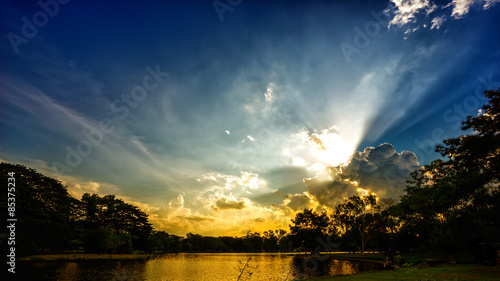 Canvas Prints Heaven Sunset scene on lake with beautiful clouds and sky