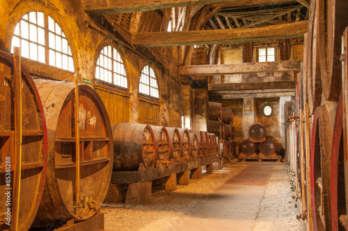 Row of oak barrels in Calvados distillery,  Normandy