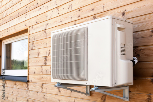 Exterior airconditioning unit on a wooden wall Canvas Print