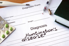 Diagnostic Form With Diagnosis Huntington Disease  And Pills.