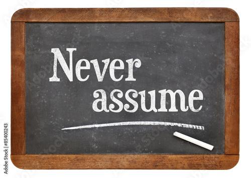 Fotografie, Obraz  Never assume advice on blackboard