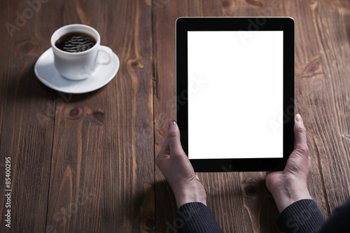 Obraz woman shows screen of digital tablet in his hands. Clipping path included. - fototapety do salonu