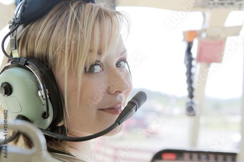Beautiful copilot on a helicopter flight. Tapéta, Fotótapéta