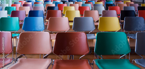Foto op Canvas Theater Rows of colorful chairs