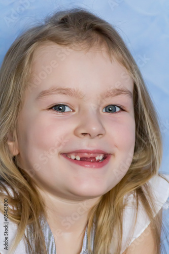 Photo  Smiling toothless girl with blond hair