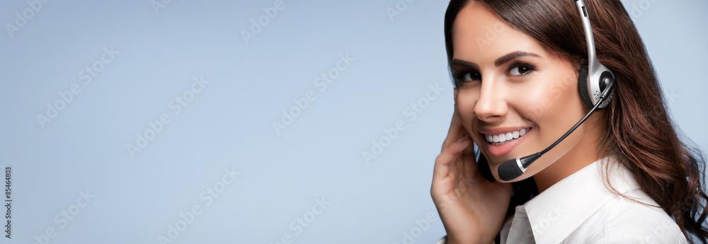 Fototapeta customer support phone operator in headset, against grey